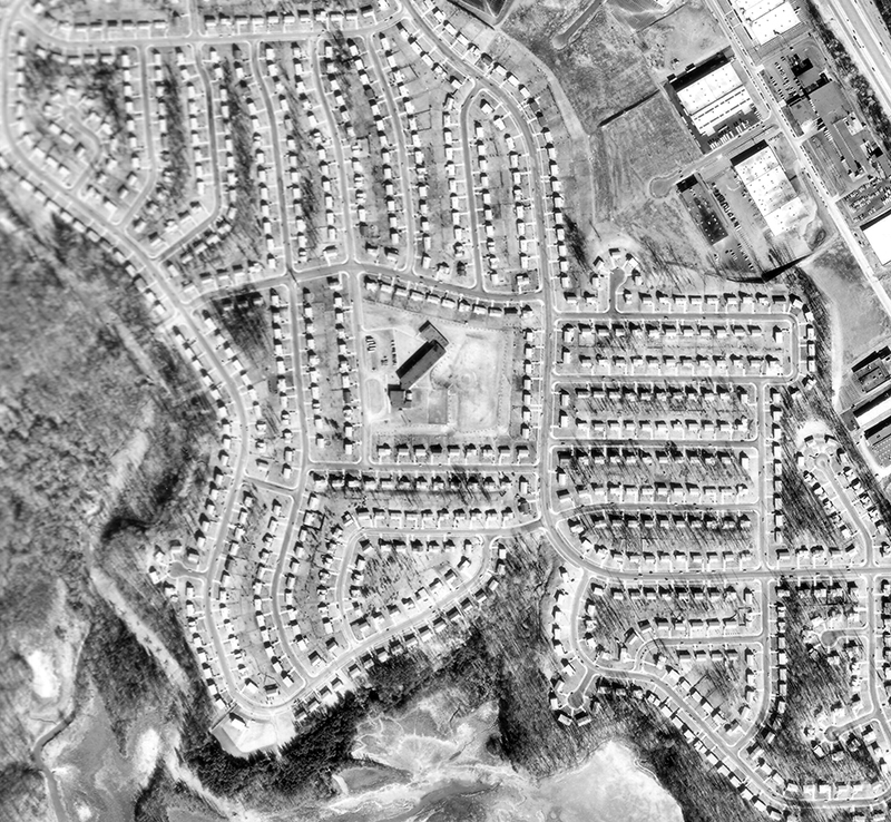Black and white aerial photograph of Ravensworth Elementary School and the surrounding community.