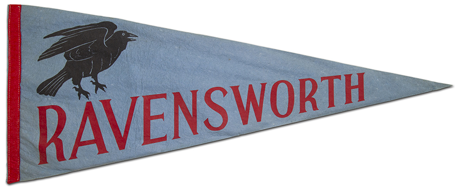 Photograph of a blue felt school pennant from the late 1960s or early 1970s.